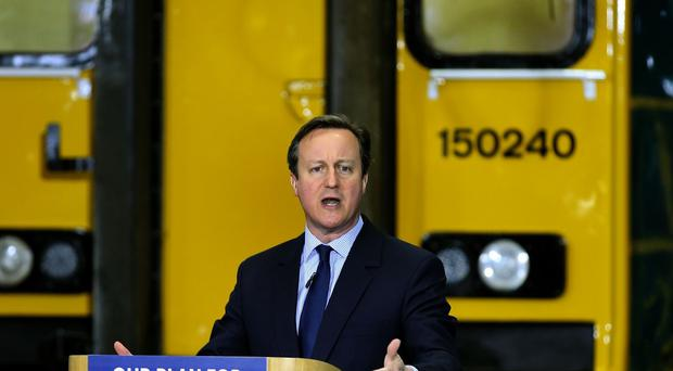 Prime Minister David Cameron speaks during a visit to Arriva TrainCare in Crewe