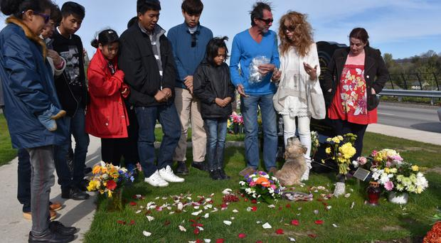 Yesterday's emotional gathering at the graveside of tsunami orphans supporter Gerry Anderson