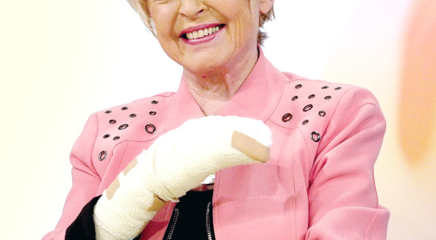 Gloria Hunniford had surgery on her crushed finger but appeared in her usual slot on television yesterday