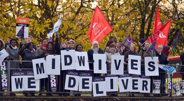 Midwives are fighting for a pay settlement