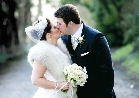 Gemma and Mark kiss on their wedding day