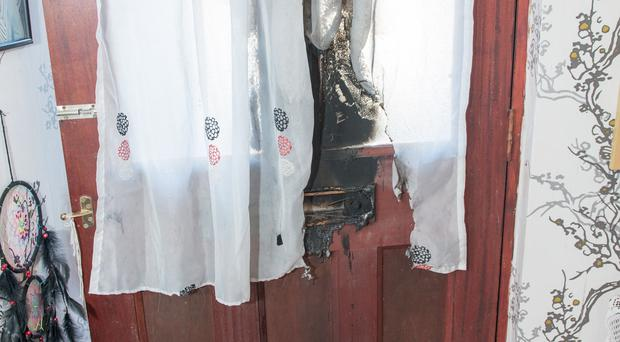 Scorch damage to Margaret O'Hara's door