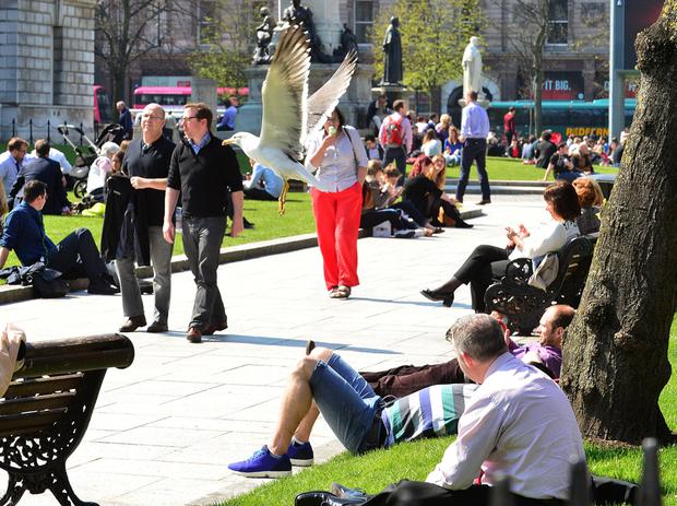 Members of the public enjoy the sunshine in Belfast City Centre