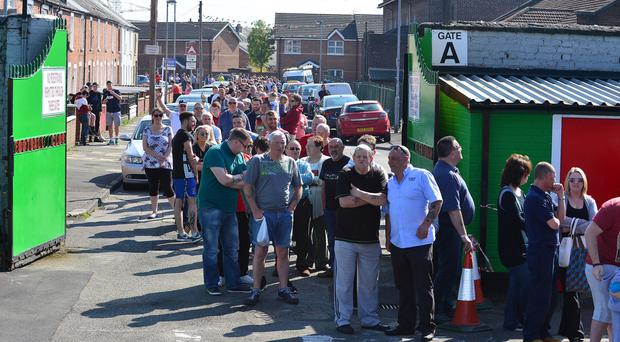 People queue up outside The Oval yesterday to buy tickets for the Irish Cup final