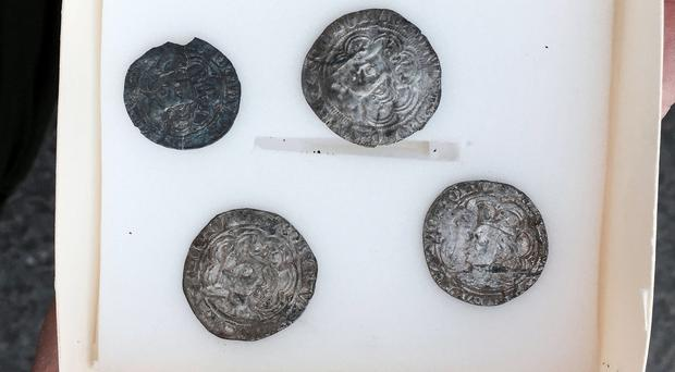 The four 14th century silver coins found by amateur treasure hunter Tom Crawford on land close to Banbridge, Co Down