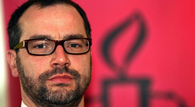 Amnesty International boss Patrick Corrigan has attacked discrimination in Northern Ireland