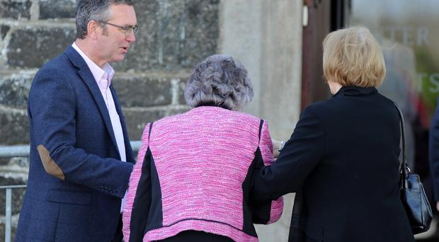 Rev Alan Kilpatrick greets parishioners before Sunday Service at Knocknamuckley Church