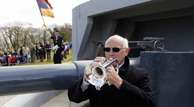 Grenville Francis sounds the Last Post at a special event at Grey Point Fort, Helen's Bay