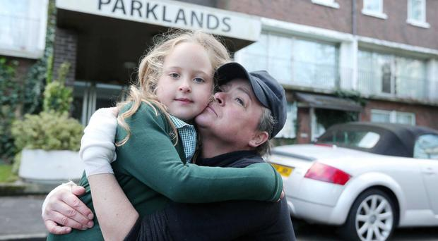 Niki Nixon with her five-year-old daughter Syah (left), who escaped serious injury after a fire broke out at the Parkland flats in the Knocknagoney area of east Belfast early yesterday