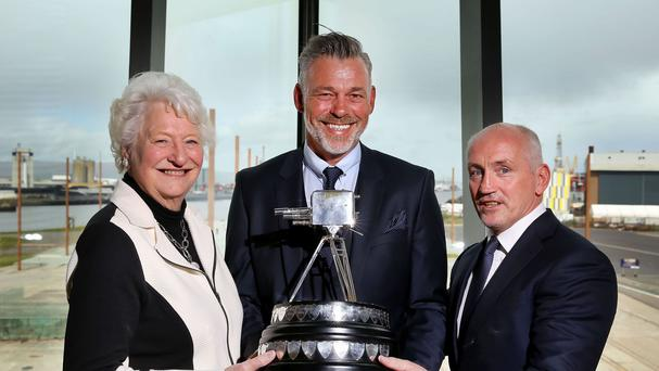 Dame Mary Peters, Darren Clarke and Barry McGuigan pose with the BBC Sports Personality of the Year trophy in the Titanic Slipway after the BBC announced the ceremony is coming to Belfast