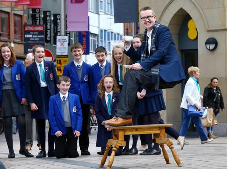 Mentalist David Meade yesterday wows pupils from St Killian's and Wellington College in Belfast city centre with a gravity-defying stunt to launch the 2016 BT Young Scientist and Technology Exhibition