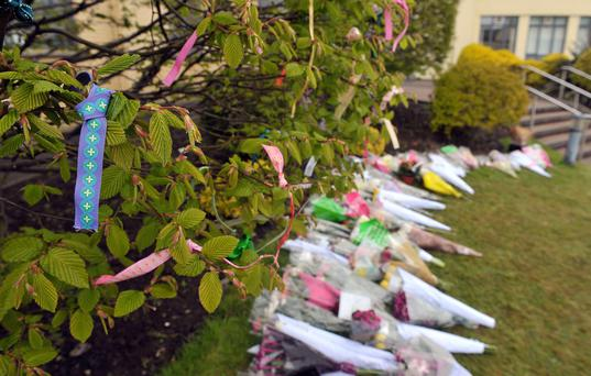 Flowers and tributes placed in the grounds of Dominican College in Belfast yesterday