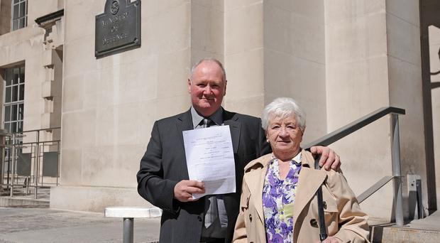 Mary Heenan and son Eugene stand outside the Ministry of Defence in London