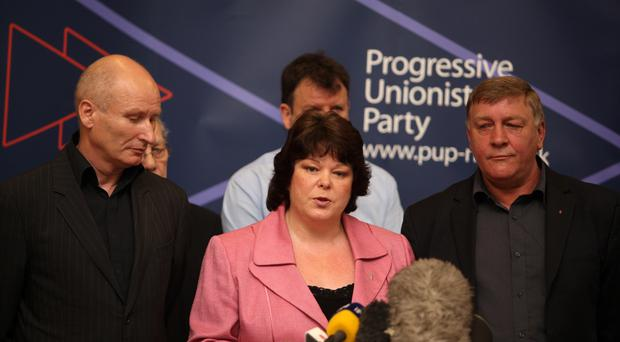 After loyalist decommissioning announcement: Dawn Purvis flanked by leading loyalists Billy Hutchinson (left) and Winston Rea (right) and the announcement in June 2009 by the UVF and the Red Hand Commando that they would be putting their weapons beyond use