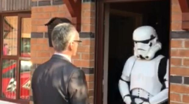 North Belfast candidate Gerry Kelly urges a Star Wars Stormtrooper to back him on May 7 (Sinn Fein/PA)