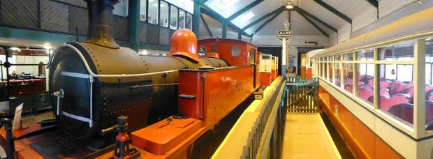 The Colmcille steam engine and a diesel rail car inside the Foyle Valley Railway museum