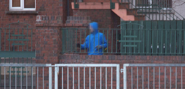 A picture of a suspected burglar in south Belfast taken by writer Malachi O'Doherty when he was out for a walk. Police are now examining the pictures as evidence