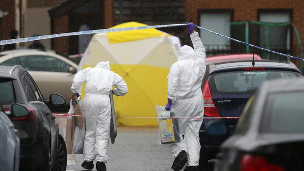 Forensic officers in the Markets area of Belfast following the fatal shooting of former IRA commander Gerard 'Jock' Davison