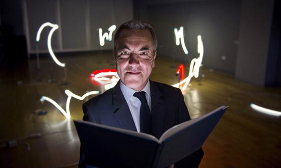 Ulster University Chancellor James Nesbitt holds a copy of the film and broadcasting report