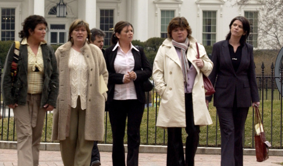 Bridgeen Hagans, fiancée of the late Robert McCartney (left), and his five sisters walk in Lafayette Park across from the White House in 2005