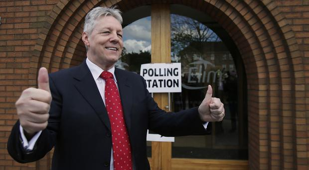 DUP leader Peter Robinson outside a polling station at Dundonald Elim Church in Belfast