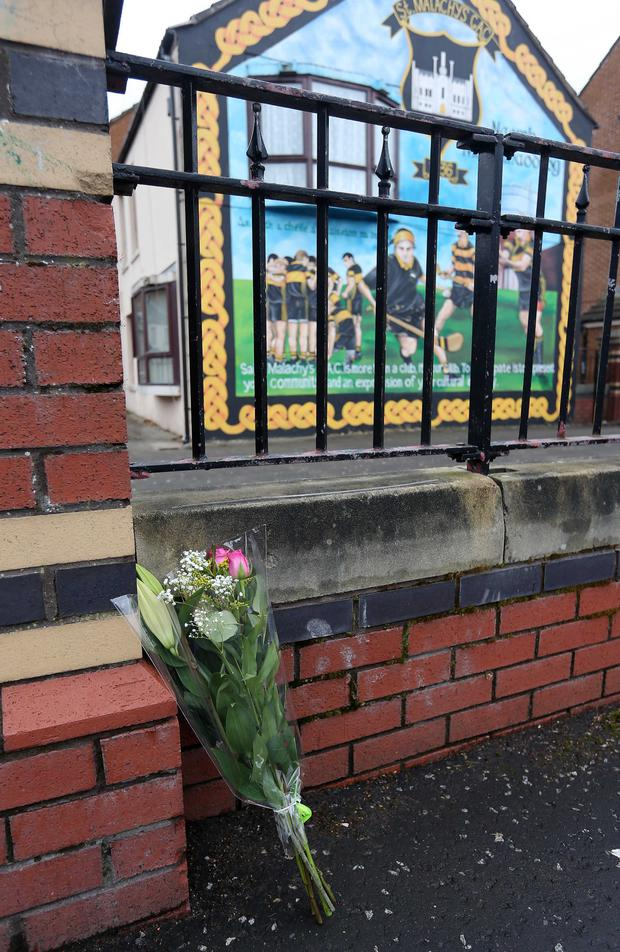 Flowers on Welsh Street in the Markets area of south Belfast at the scene where Gerard Davison was shot dead