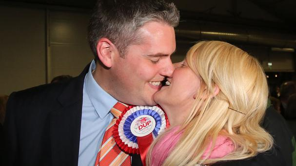The DUP's Gavin Robinson kisses his wife Lindsay after winning the East Belfast parliamentary seat at the Kings Hall in Belfast.