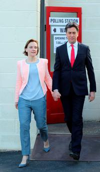 Labour leader Ed Miliband and his wife Justine leave after casting their votes at Sutton village hall in Doncaster yesterday