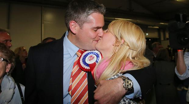 The DUP's Gavin Robinson kisses his wife Lindsay after winning the East Belfast parliamentary seat