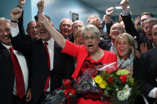 SDLP's Margaret Ritchie celebrates her win at the South Down count in Lisburn