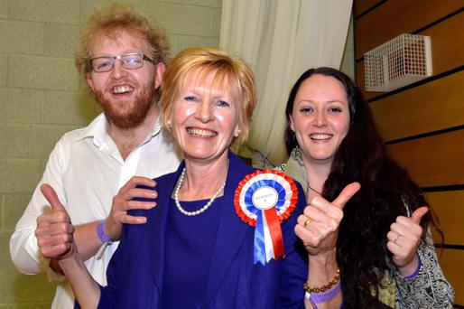 Lady Hermon celebrates with her son Thomas and his fiancée Gabrielle Logan