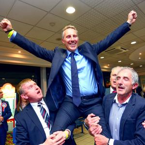 A triumphant Ian Paisley is carried shoulder-high after election victory
