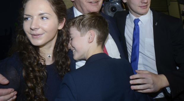 Alasdair McDonnell is congratulated by his family after win
