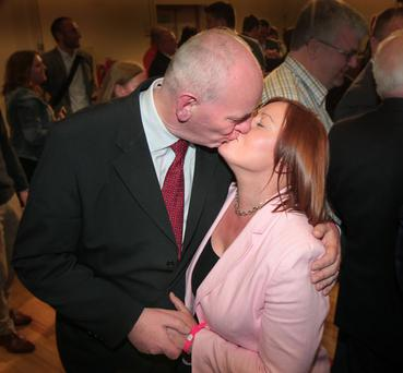 Mark Durkan shares a kiss with wife Jacqui after topping the poll in Foyle