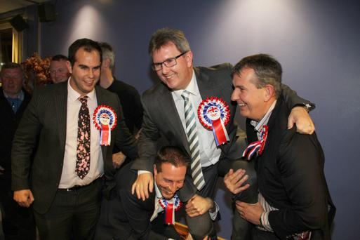 DUP colleagues prepare to lift a victorious Jeffrey Donaldson