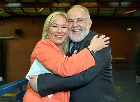 Sinn Fein's Francie Molloy is congratulated by Michelle O'Neill, the Agriculture Minister, after he won the Mid Ulster seat