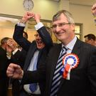 Tom Elliott of the Ulster Unionist Party celebrates with party members including leader Mike Nesbitt after taking the seat from Sinn Fein's Michelle Gildernew