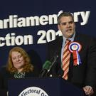 The DUP's Gavin Robinson makes his speech after winning the East Belfast seat from Alliance's Naomi Long (left)