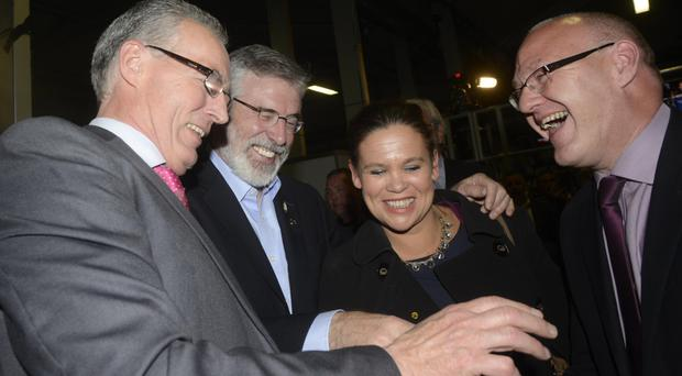 Sinn Fein's Gerry Adams with party members Gerry Kelly, Mary Lou McDonald and Paul Maskey at Belfast's King's Hall