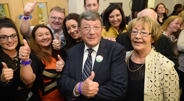 Sinn Fein's Pat Doherty celebrates with his family and friends after the announcment of his victory in West Tyrone