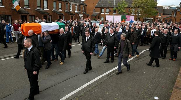 The coffin of Gerard 'Jock' Davison, a former IRA commander, is carried on Friendly Street, Belfast.