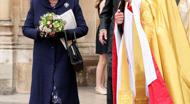 The Queen with the Dean of Westminster, the Very Rev Dr John Hall, leaving the Service of Thanksgiving at Westminster Abbey to mark the 70th anniversary of VE Day