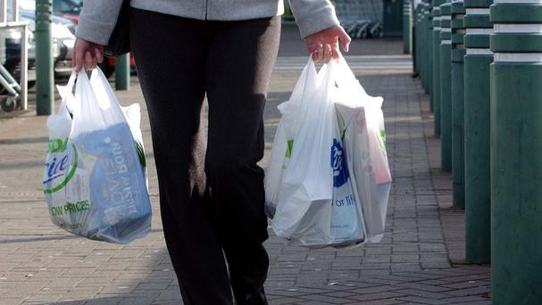 Mark H Durkan said £4.2 million raised through the carrier bag levy would be used to ease the pain of organisations whose funding was cut in the Stormont budget