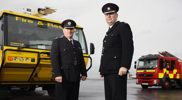 Chris Kerr, right, has spent 30 years in the fire service (Belfast City Airport/PA Wire)
