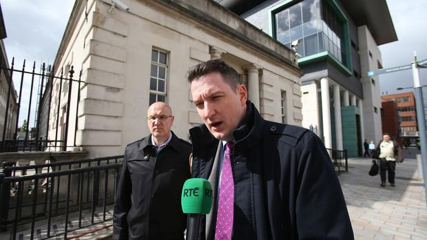 John Finucane, foreground, said the Government's decision not to hold a public inquiry into the murder of father Pat Finucane would have a