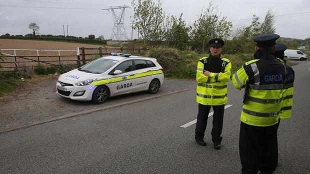 Gardai investigate at the scene where a baby was found abandoned on Steelstown Road in Rathcoole, Co Dublin, last Friday, as they issued a fresh appeal for information to try to identify the baby and her parents