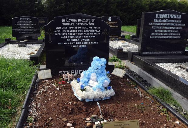 The grave of three-year-old Brendan Owens, which he shares with his great-grandparents