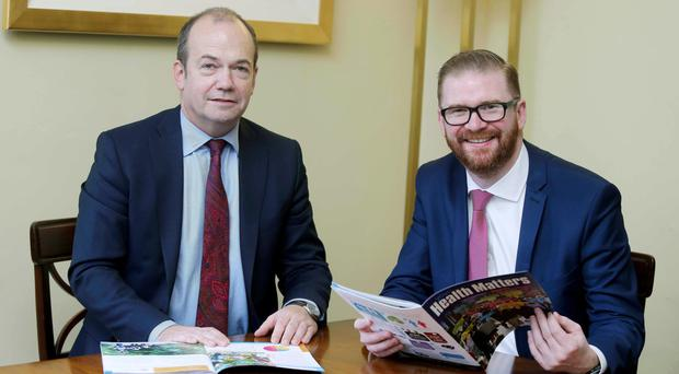 Chief medical officer Dr Michael McBride (far left) with new Minister of Health Simon Hamilton as he launches his eighth annual report yesterday