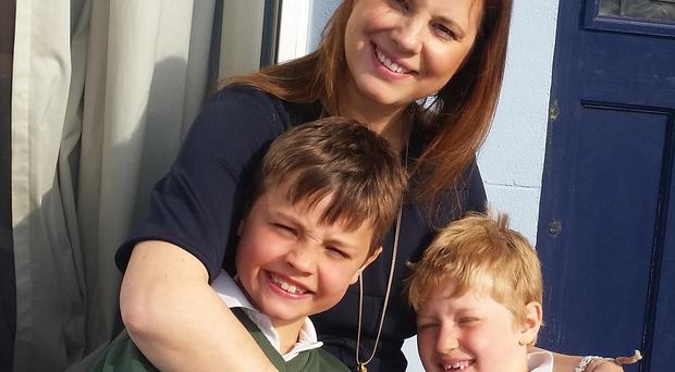 Clea Driscoll with her sons Bobby, aged seven and Tom, aged five, whose lives have been 'severely disrupted' by aircraft noise (Belfast City Airport Watch/PA)