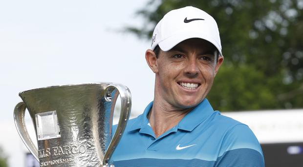 Rory McIlroy poses with the trophy after winning the Wells Fargo Championship golf tournament (AP)